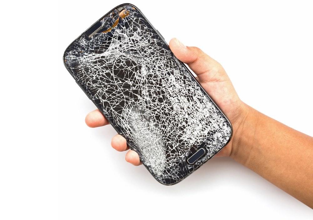 bigstock-Hand-Holding-Broken-Smart-Phon-110184953-3-1